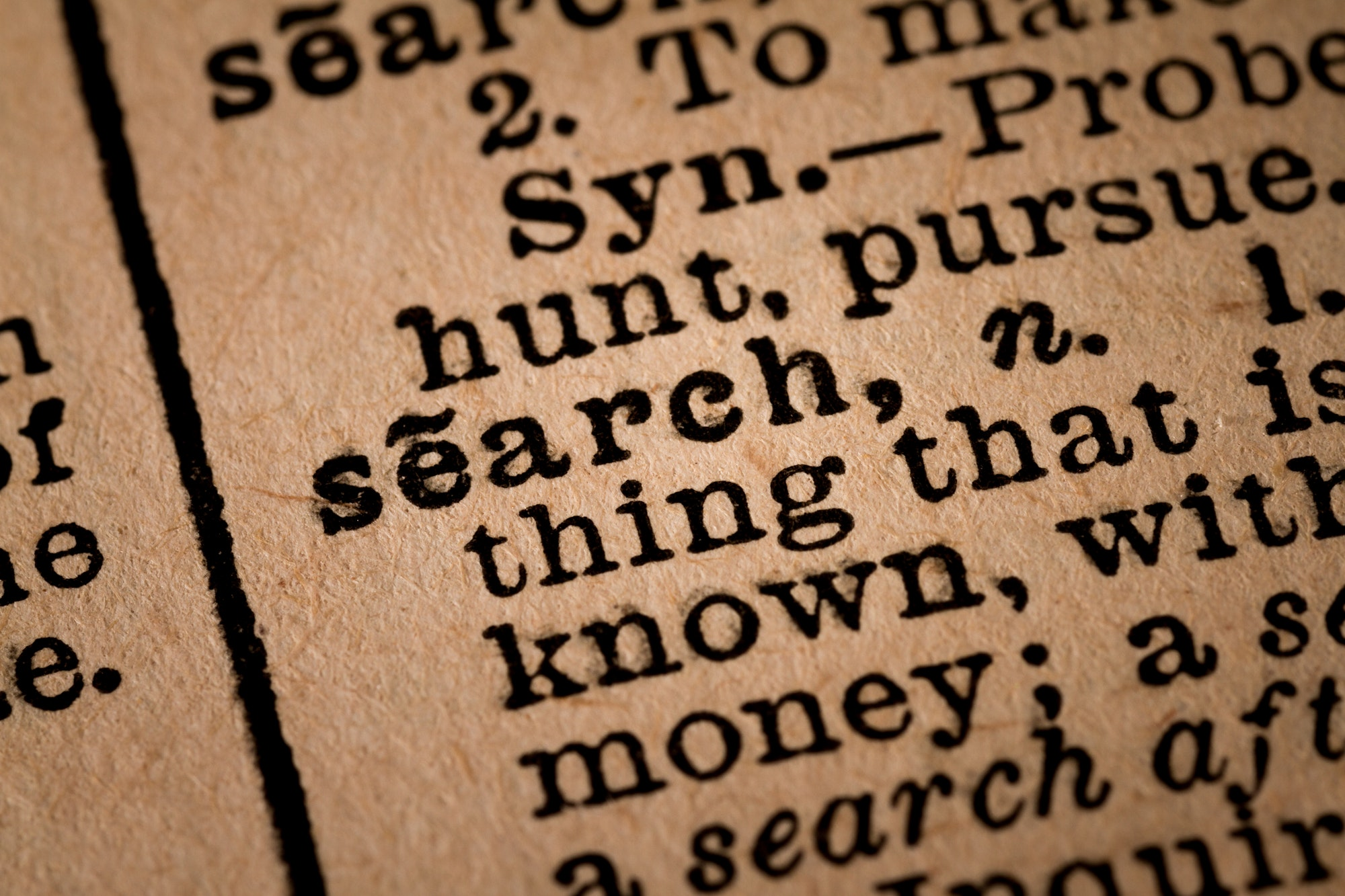 Close-up of an Opened Dictionary showing the Word SEARCH